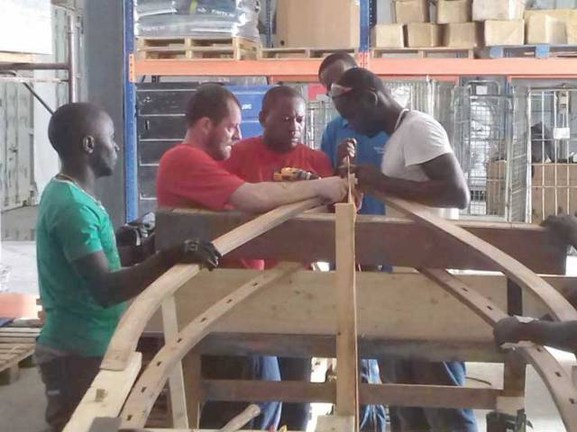 Seamus-O'Brien (second from left) making the currach with the local workforce in Haiti