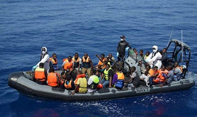 Migrants rescued in an operation that included recovery of bodies from a pair of rubber craft off Libya