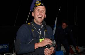 Bird in the hand - Tom Dolan arrives on the dock with a feathered friend in Roscoff last night after another tough leg of the Figaro Race