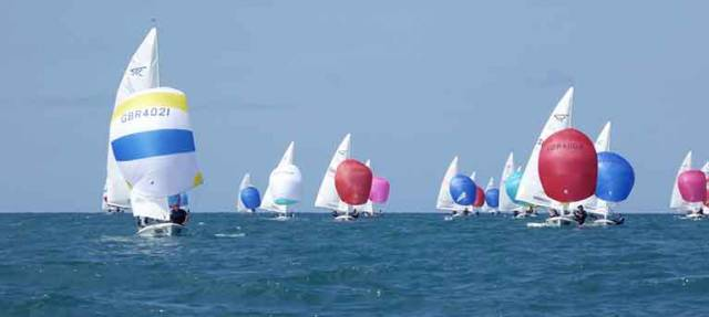 The National Yacht Club's Charles Apthorp and Alan Green (closest red spinnaker above) were third in the penultimate race in New Zealand yesterday
