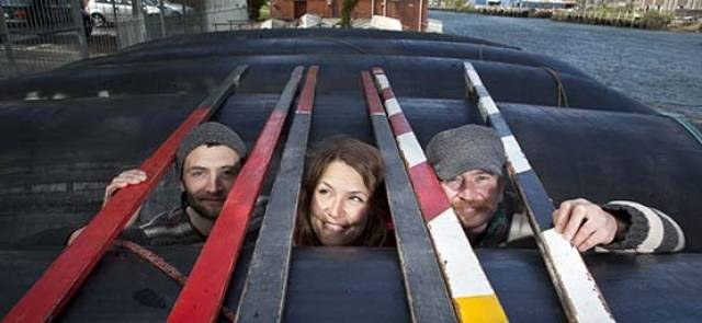 Forrest Moore, Joya kuin and Kieran Curtin pictured preparing the boats for Ocean to City and Cork's Maritime festival which is organised by Meitheal Mara