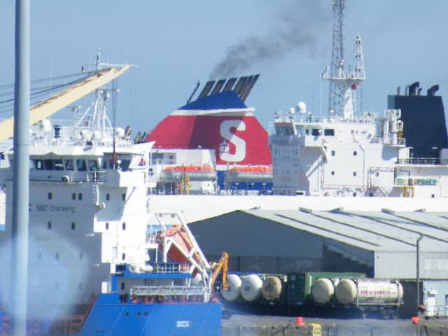 A busy scene at Dublin Port with a ferry among cargoships