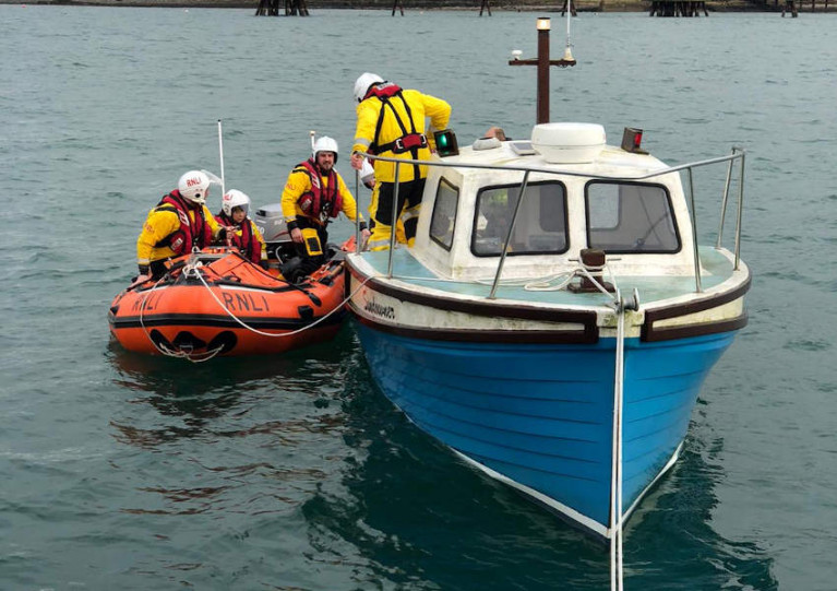 Larne RNLI's crew sets up an alongside tow for the casualty boat