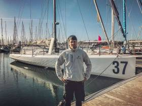 Nicholas 'Nin' O'Leary at Dun Laoghaire Marina with his IMOCA 60