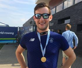 Paul O'Donovan with his gold medal in Rotterdam today. Scroll down for video