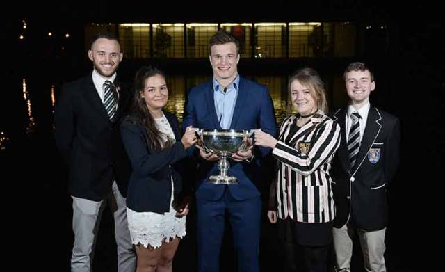 Max Murphy, UCD, Ruth Gilligan, UCD, International rugby player Josh Van Der Flier with the Gannon Cup, Megan Jungmann, TCD and Cian Flynn, TCD.