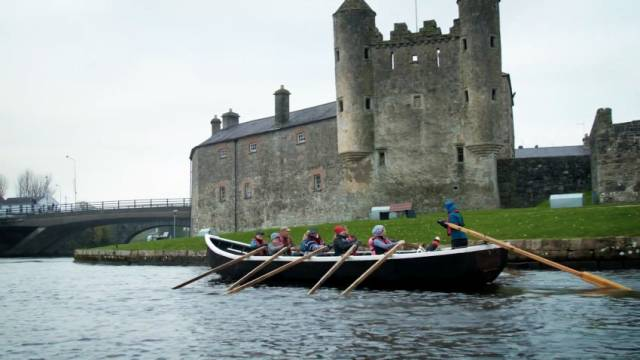 Row the Erne take their community-built curragh out on the river
