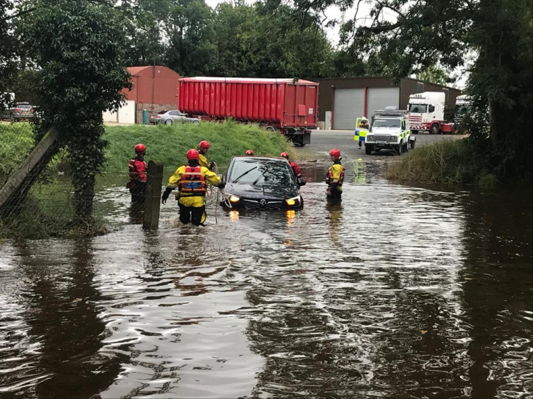 Rescue teams attend flooded streets in Newcastle after Storm Francis