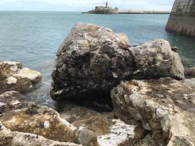 A large piece of stonework dislodged from the roundhead apron at Dun Laoghaire's West Pier