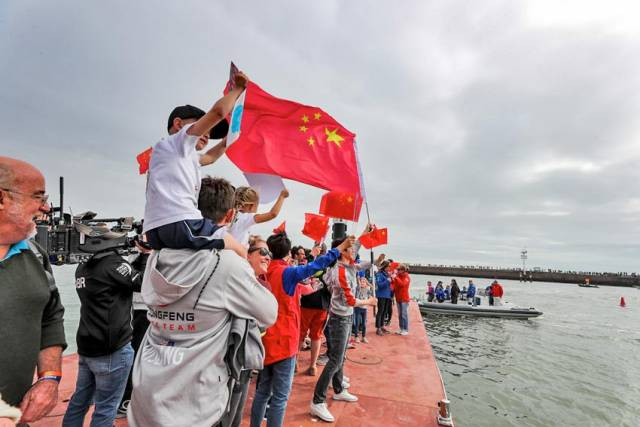 A young fan celebrates the Chinese-flagged Dongfeng Race Team's victory in The Hague this afternoon