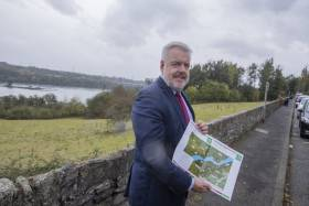 The day after First Minister of Wales, Carwyn Jones visited Dun Laoghaire for the Irish state ceremony to commemorate the sinking of RMS Leinster a century ago, the Minister (above) then visited the Menai Strait, Anglesey, north Wales (with background of Britannia Bridge) to announce the preferred route for the 3rd Menai crossing. This option will improve journey times on the A55 route (to and from Port of Holyhead) and provide safer travel across the Menai Strait.