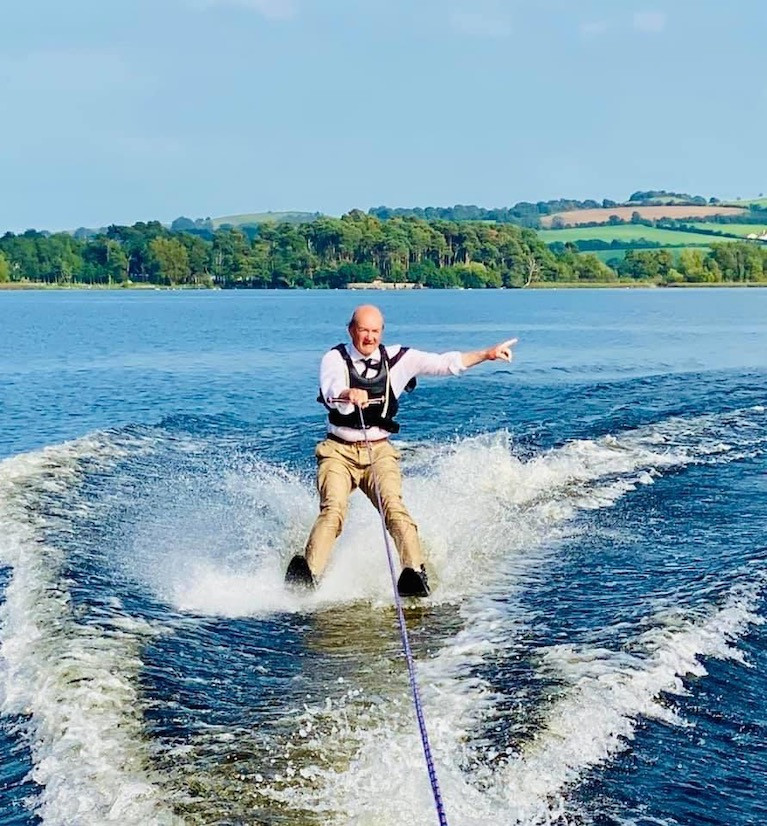 Alan Algeo, former Commodore of Lough Ree YC, feels he has to dress properly when water-skiing on strange waters, and we're assured that's his Lough Ree YC tie he's wearing while cutting a dash on Lough Derg, with the Tipperary Riviera looking its luscious best