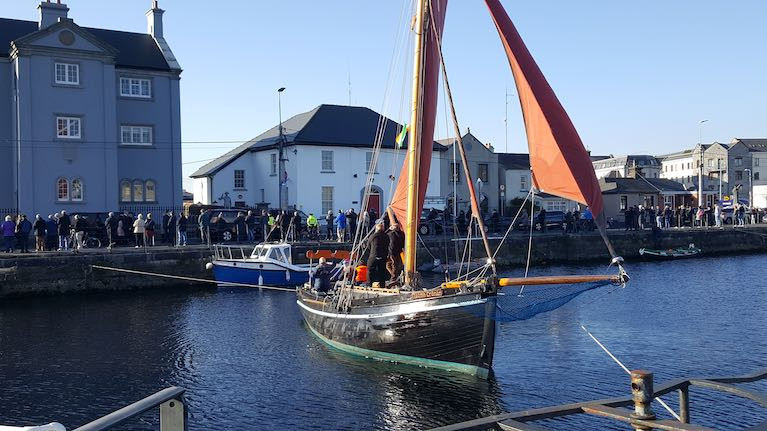 A Galway hooker crew paying respect to Martin and Tom Oliver and their bereaved relatives at Claddagh church