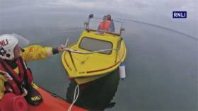 Bangor RNLI towing the broken down motorboat to Carrickfergus