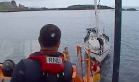 Howth RNLI All weather lifeboat tows the yacht. See video below.