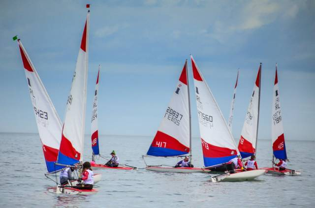 Topper dinghies reach a weather mark in the first day of racing for the class at the Irish Sailing Youth Pathway National Championships