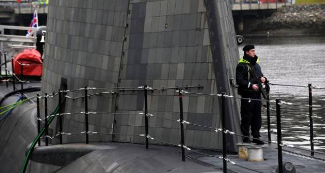 An armed guard on Astute-class nuclear submarine HMS Artful in 2016. The Royal Navy has not released information identifying which submarine was involved in the near-miss.