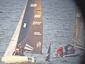 Justin Burke's SB20 Alert Packaging gives chase at Bay mark in last night's DBSC race