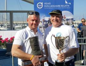 Dave Gorman (left) and Chris Doorly with the Boat of the Week 'Dubarry Boot' Trophy and Flying Fifteen Cup