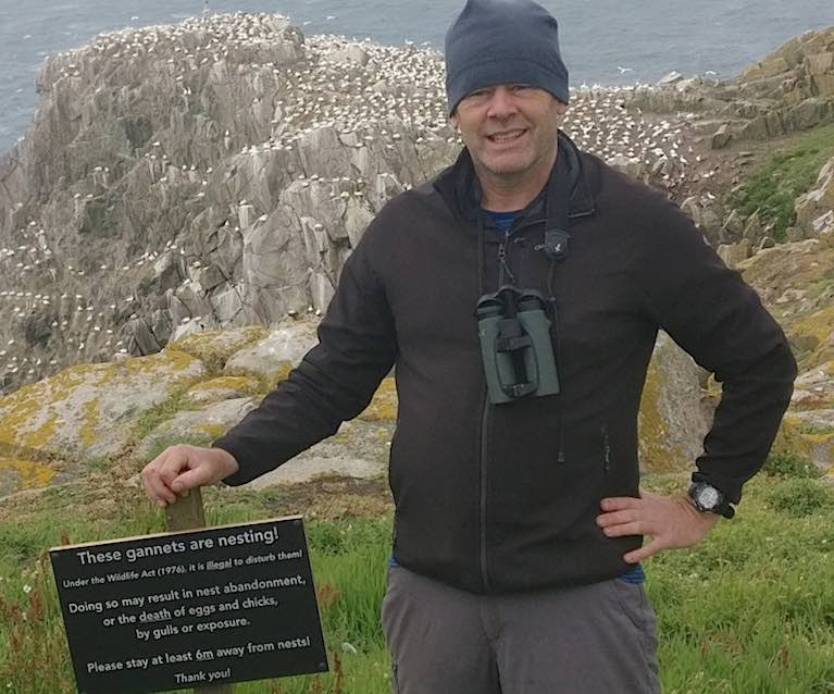 Professor John Quinn with the Gannet colony sign on the Great Saltee Islands