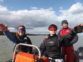 Instructors in powerboats while blindfolded during a Bray Sailing Club training session