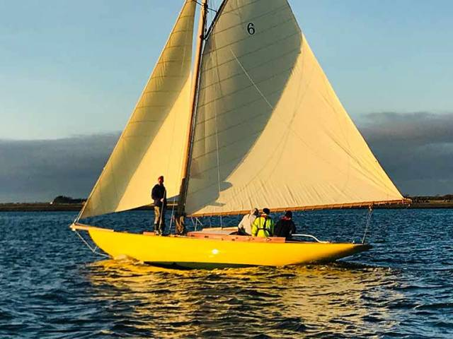 """The light of other days….."" The Dublin Bay 21 Naneen sails for the first time in 33 years in the otherworldly illumination of December sunshine on the Shannon Estuary. Photo: Kate Griffiths"
