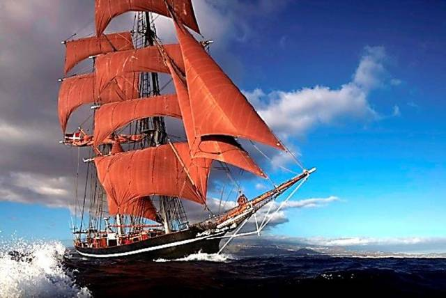 Eye of the Wind with its distinctive reddish brown sails unfurled