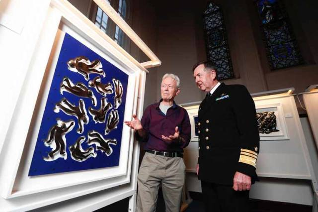 Artist Philip Murphy (left) pictured beside his art piece adrift with the chief of staff of the Defence Forces Vice Admiral Mark Mellett
