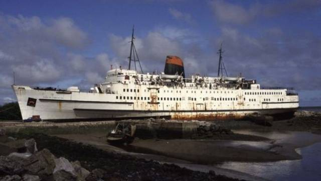 "Duke of Lancaster in north Wales, where the Zombie Infection company says it will restore the ship to its ""former glory"". AFLOAT adds the former Irish Sea ferry during its British Rail / Sealink career included operating out of Dun Laoghaire Harbour on the route to Holyhead when providing summer support and during the entry of the new St. Columba in 1978.  In that year the 'Duke' was withdrawn from service and retired, initially going into lay-up in Barrow-in-Furness, Cumbria, England."
