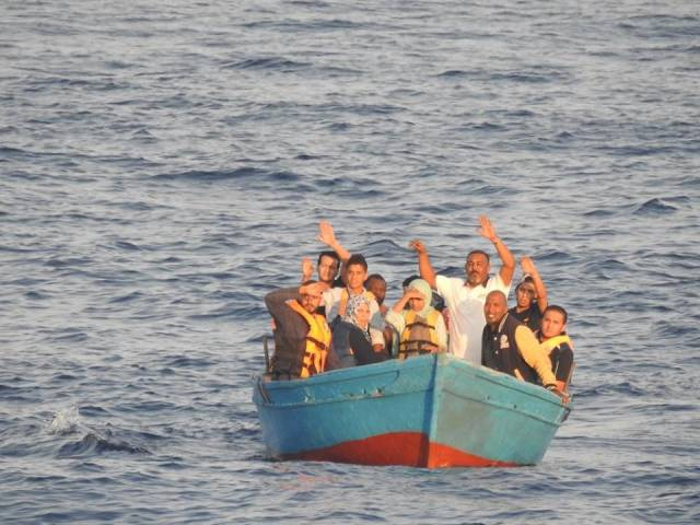 Migrants rescued from a wooden vessel located 40 Nautical Miles of Tripoli, Libya