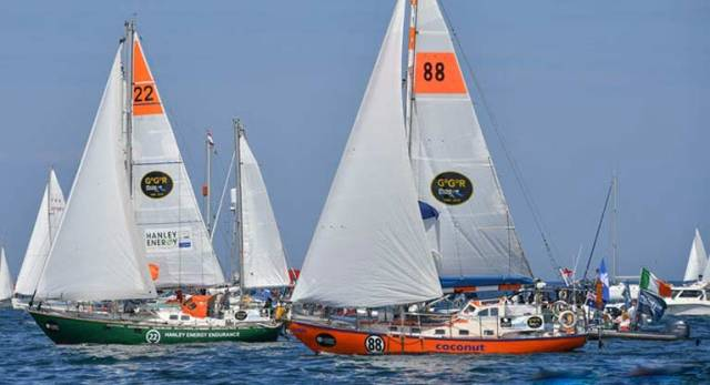 Gregor McGuckin's Hanley Energy Endurance (left) at the start of the Golden Globe Race on 1st July at les Sables d'Olonne. Currently leading the ketch-rigged boats, he is expected to cross the equator today