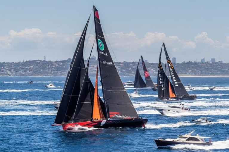 Racing for line honours: the SuperMaxis Comanche (Jim Cooney), Wild Oats XI (Oatley family) and Infotrack (ex Rambler 100, Christian Beck) making knots for Hobart in the 2018 race