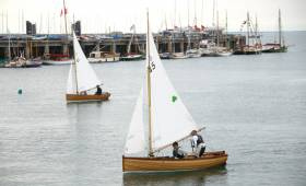 Traditional Water Wags Number 41 Mollie (Claudine Murphy) and Number 45 Mariposa, (Cathy MacAleavey) sail past the assembled Classic boat fleet at the Carlisle Pier adjacent to the National Yacht Club in Dun Laoghaire