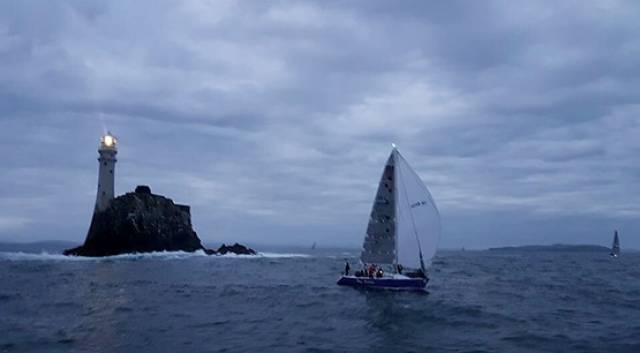 The RNLI Baltimore team sailing the yacht True Penance rounds the Fastnet Rock last night in the first race of Cork Week's Beaufort Cup
