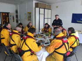 A very happy Valentia lifeboat crew dines on Derry Clarke's seafood treats
