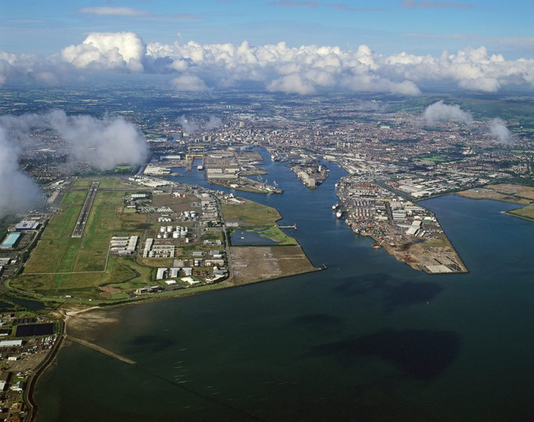In this aerial view of Belfast Harbour's port estate note alongside on the left is the George Best Belfast City Airport, one of two that serve the Ulster capital.