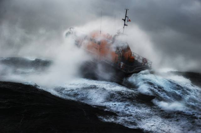 An RNLI Lifeboat operating in stormy seas