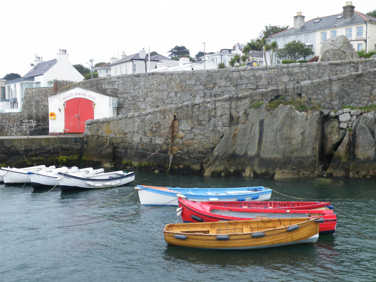 The passenger ferryboat service to Dalkey Island in south Dublin Bay is not operating following the partial collapse of the cliff within Coliemore Harbour resulting in the closure of the harbour' s access walkway path to the ferry-pier and the Dalkey Rowing Club boathouse (also above) due to health and safety grounds. On the right can be seen the gap where a large rock became dislodged, dropped directly into the water below.