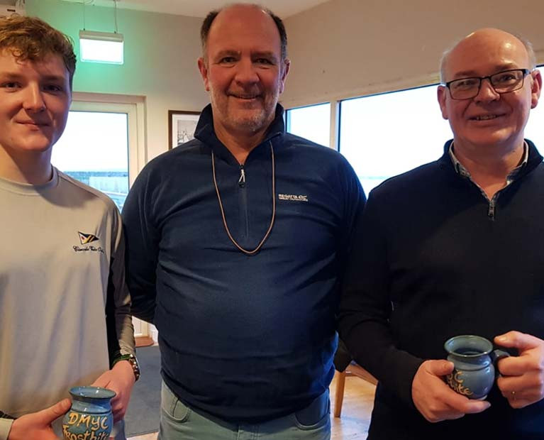 Peter & Stephen Boyle (GP14) pick up their Frostbite Mug from Race Officer Cormac Bradley (centre)
