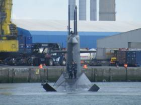 "The ""X"" tail configuration of the stern of Dutch submarine HNLMS Walrus having swung from a berth in Alexandra Basin to depart Dublin Port"