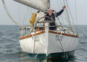 Sir Robin Knox Johnston on Suhaili celebrates his 50th anniversary of becoming the first person to sail solo and non stop around the world