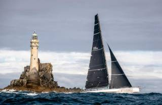 Rambler 88 rounds the Fastnet on her way to monohull line honours victory