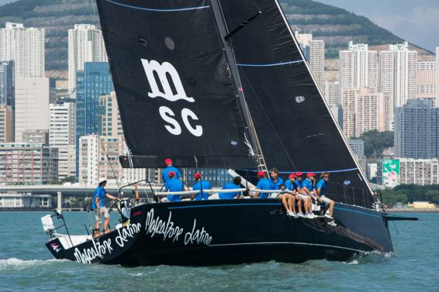 The superbly-prepared Cookson 50 Mascalzone Latino off Hong Kong's spectacular waterfront for the start of the race to Vietnam.