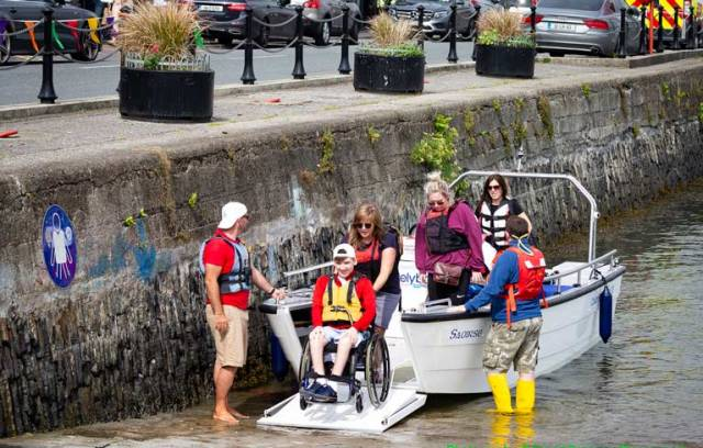 Enable Ireland participants Callum O'Mahony from Douglas with volunteers taking part on board the Wheelyboat at the Watersports Inclusion Games 2019