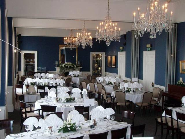 The main dining room at the National Yacht Club hosts this evening's gathering for new and prospective members