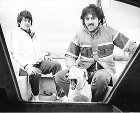 Alistair, (right) Arthur Rumball and Bobo the Dog from the early days of the INSS sailing a Sherrif Day Sailor in Dun Laoghaire Harbour