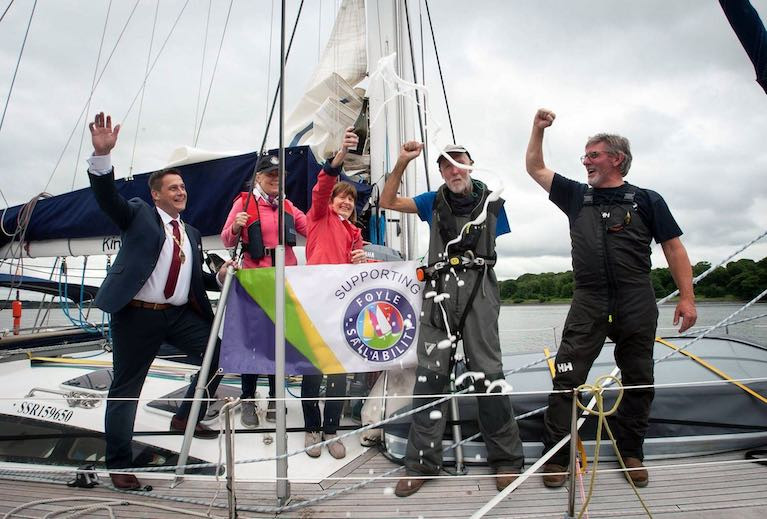 Solo sailor Gary Crothers (second from right) is congratulated on returning home to Derry this summer in his yacht a Kind of Blue