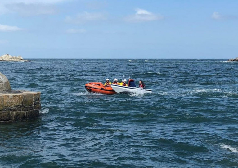 Dun Laoghaire's inshore lifeboat assisting the small rowing boat on Sunday afternoon