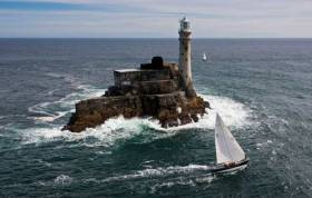 The 48ft American sloop Carina (Rives Potts) rounding the Fastnet Rock in 2011, when she won her class. A successful veteran of the 1979 Fastnet Race, Carina made her debut in the 1969 race, and today she starts in her Golden Jubilee Fastnet Race