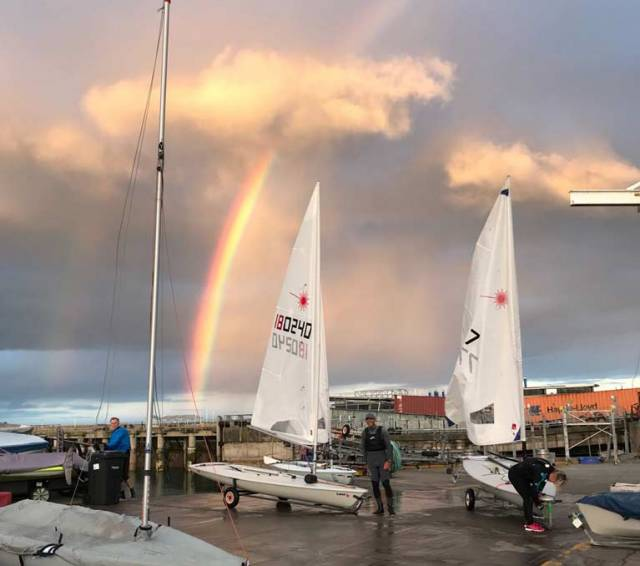 A rainbow appears on Dublin Bay as Laser sailors come ashore at the RStGYC in Dun Laoghaire